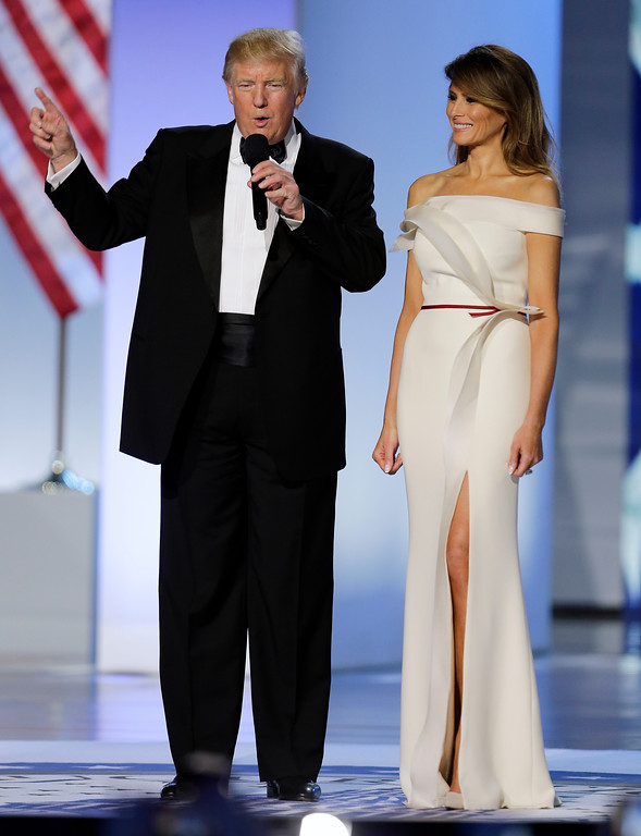. FILE - In this Jan. 20, 2017 file photo, President Donald Trump with first lady Melania arrive at the Freedom Ball in Washington at the Washington Convention Center during the 58th presidential inauguration. Slovenian-born Melania Trump has been unafraid to go against her husband�s �America First� agenda, and stay true to her roots, if there�s a message to be taken from her bold, foreign-flavored first lady wardrobe in 2017.   (AP Photo/Mark Tenally)
