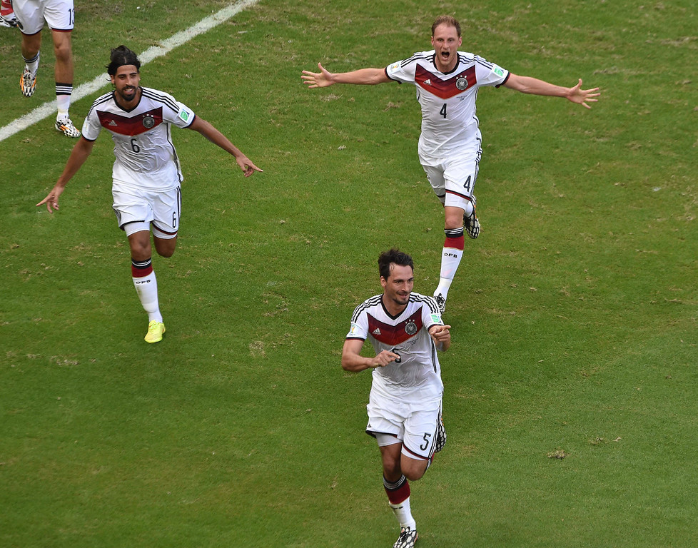 . Germany\'s midfielder Sami Khedira (Front) celebrates scoring with his teammates during the Group G football match between Germany and Portugal at the Fonte Nova Arena in Salvador during the 2014 FIFA World Cup on June 16, 2014.  DIMITAR DILKOFF/AFP/Getty Images