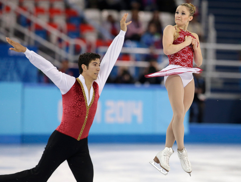 . Paige Lawrence and Rudi Swiegers of Canada compete in the pairs free skate figure skating competition at the Iceberg Skating Palace during the 2014 Winter Olympics, Wednesday, Feb. 12, 2014, in Sochi, Russia. (AP Photo/Darron Cummings)