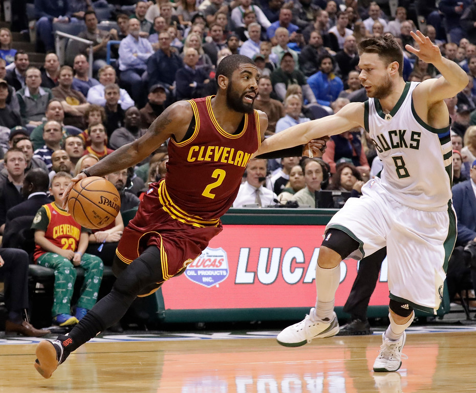 . Cleveland Cavaliers\' Kyrie Irving drives past Milwaukee Bucks\' Matthew Dellavedova during the first half of an NBA basketball game Tuesday, Nov. 29, 2016, in Milwaukee. (AP Photo/Morry Gash)