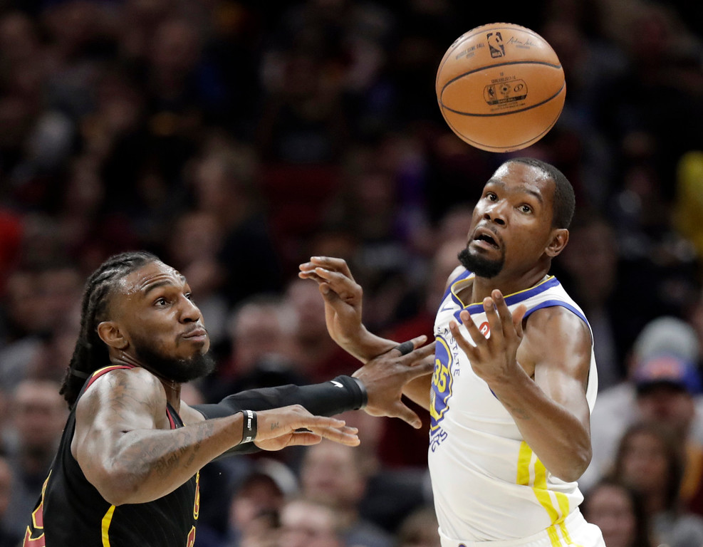 . Cleveland Cavaliers\' Jae Crowder, left, knocks the ball loose from Golden State Warriors\' Kevin Durant in the first half of an NBA basketball game, Monday, Jan. 15, 2018, in Cleveland. (AP Photo/Tony Dejak)