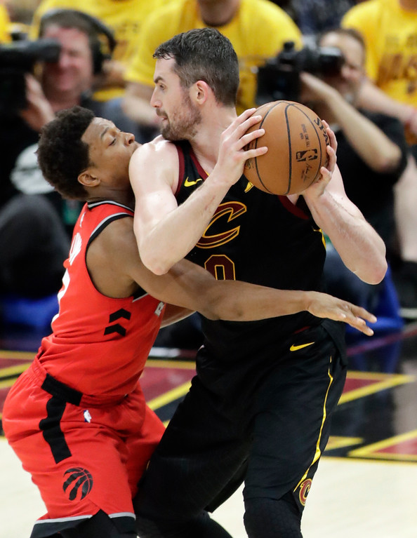 . Toronto Raptors\' Kyle Lowry defends Cleveland Cavaliers\' Kevin Love in the second half of Game 4 of an NBA basketball second-round playoff series, Monday, May 7, 2018, in Cleveland. (AP Photo/Tony Dejak)