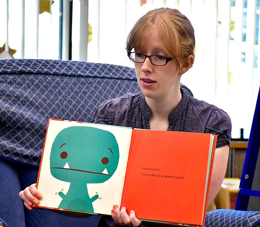 7/3/2019 Mike Orazzi | Staff Children's Librarian Evelyn Fisher reads about dinosaurs during story time at the Manross Library in Bristol on Wednesday.