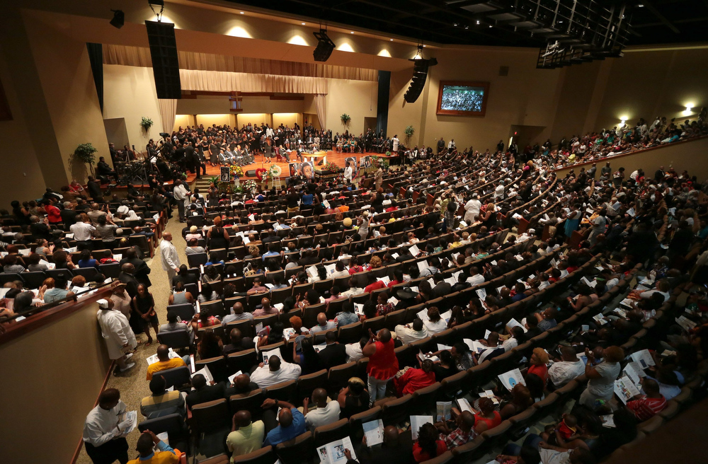 Description of . Hundred gather for the funeral services for Michael Brown on Monday, Aug. 25, 2014, at Friendly Temple Missionary Baptist Church in St. Louis. Michael Brown, 18, was shot and killed by a Ferguson police officer on Aug. 9, 2014. (AP Photo/St. Louis Post Dispatch, Robert Cohen, Pool)