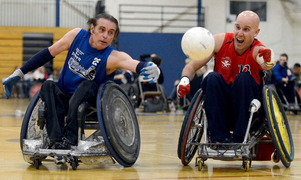. DENVER, CO. - FEBRUARY 10: Weasel Luxembourger (25) of the Northridge Knights and A-Jay Nagle (13) of the Northridge Knights reach out for the ball during the Wheelchair Rugby Tournament February 10, 2013 at Englewood High School.  The Mile High Mayhem was put on by Craig Hospital and city of Englewood.(Photo By John Leyba/The Denver Post)