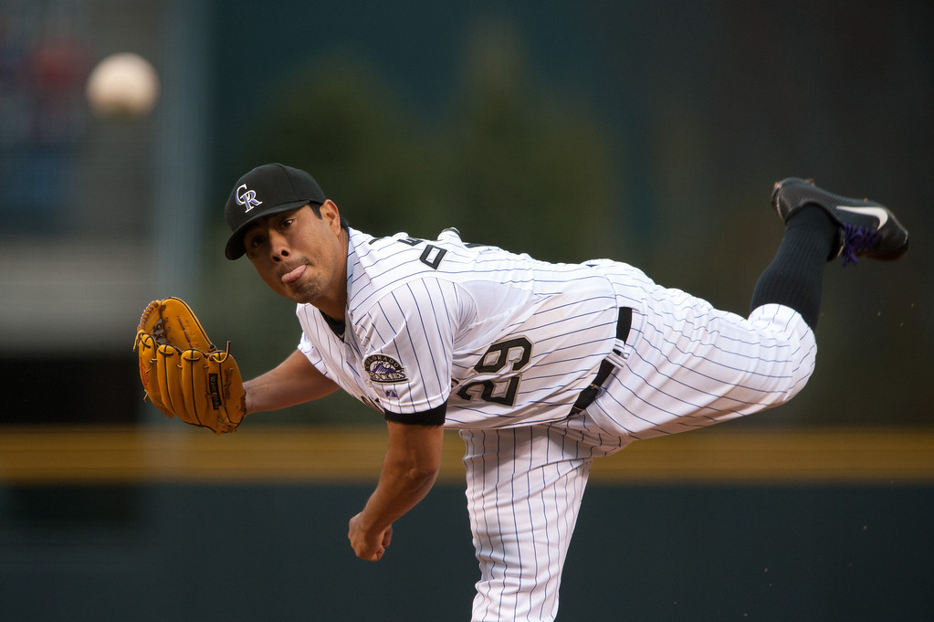 . DENVER, CO - APRIL 20:  Jorge De La Rosa #29 of the Colorado Rockies pitches against the Arizona Diamondbacks in the first inning of a game at at Coors Field on April 20, 2013 in Denver, Colorado.  (Photo by Dustin Bradford/Getty Images)
