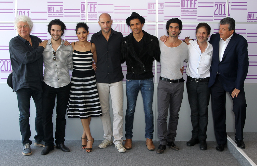 ". (L-R) Director Jean-Jacques Annaud, actors Tahar Rahim; Freida Pinto, Mark Strong, Jan Uddin, Akin Gazi, composer James Horner and producer Tarak Ben Ammar attend the ""Black Gold\"" photocall at the Press Centre during day 1 of the 2011 Doha Tribeca Film Festival on October 25, 2011 in Doha, Qatar.  (Photo by Sean Gallup/Getty Images for Doha Film Institute)"
