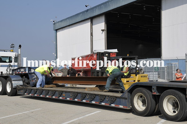 LEVITTOWN FD AT JFK HANGAR 17 FOR WTC STEEL BEAM