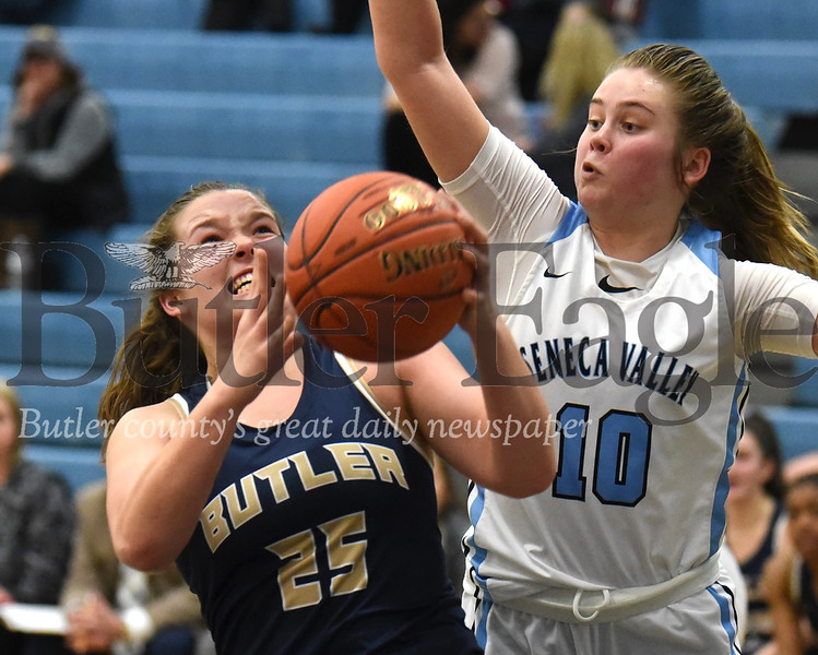 Butler's Hailey Metzger(25) pushes past Seneca Valley's Haley Cramer (10)  for a layup in the Golden Tornado's 59-46 loss at Seneca Monday night. Seb Foltz/Butler Eagle