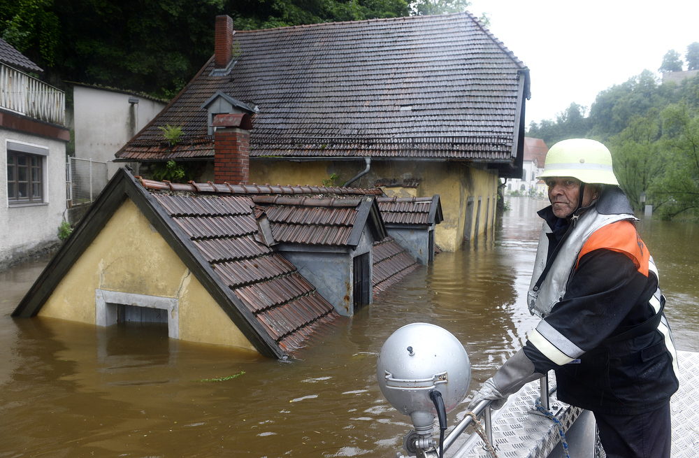 . A rescuer navigates through an overflooded street in Passau, southern Germany, on June 3, 2013. Parts of the eastern and southern Germany were flooded due to heavy and ongoing rainfalls.  CHRISTOF STACHE/AFP/Getty Images