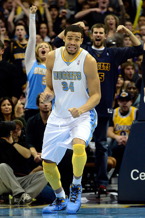 . Denver Nuggets center JaVale McGee (34) reacts to a big dunk against the Los Angeles Lakers during the second half of the Nuggets\' 126-114 win at the Pepsi Center on Wednesday, December 26, 2012. AAron Ontiveroz, The Denver Post