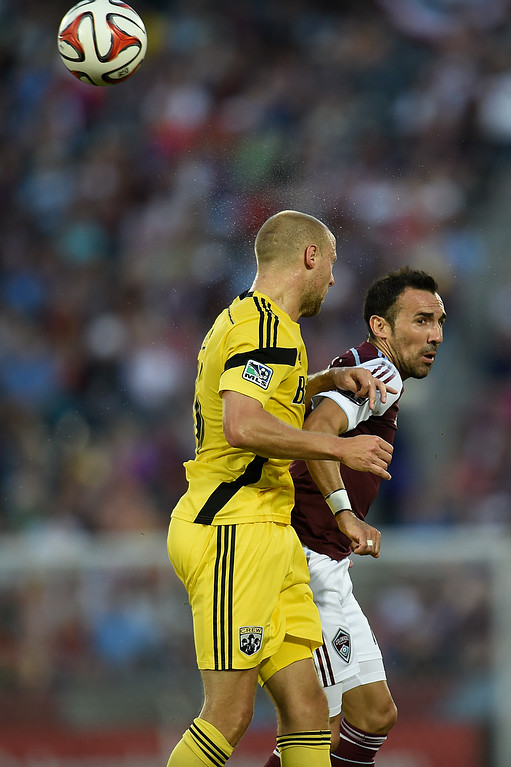 . Vicente Sánchez #7 of the Colorado Rapids (R) jumps for a header against Eric Gehrig #16 of the Columbus Crew during an MLS game at Dick\'s Sporting Goods Park on July 4, 2014, in Commerce City, Colorado. (Photo by Daniel Petty/The Denver Post)