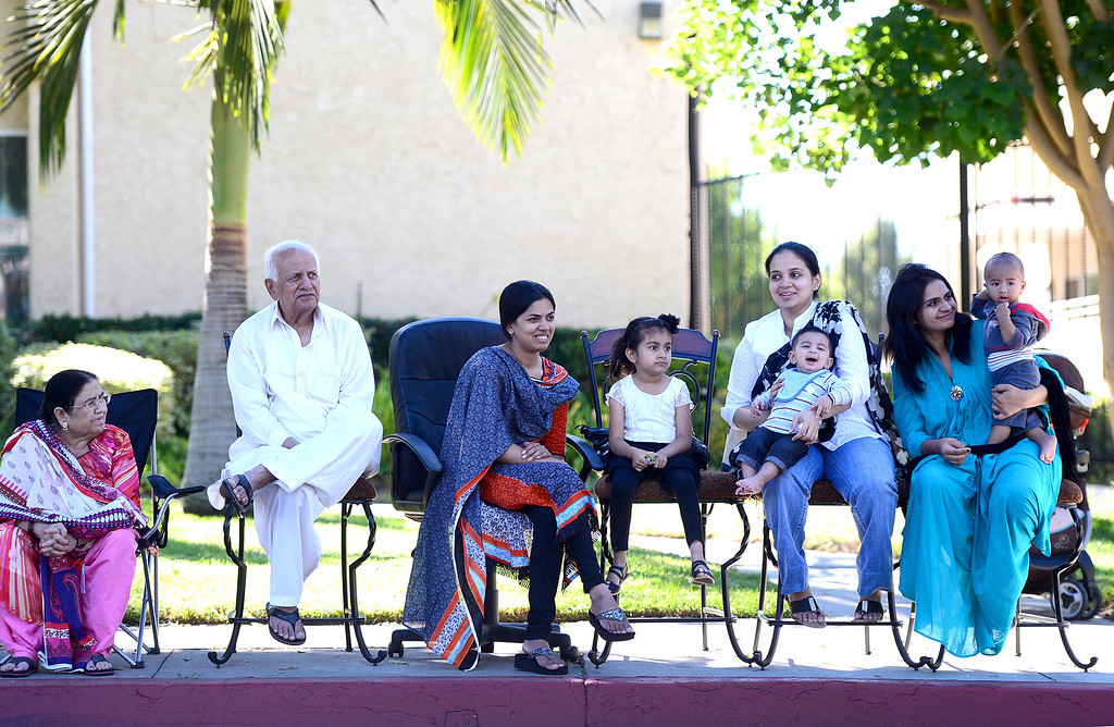 . The Hussain Family watches City of Duarte\'s annual Route 66 Parade in front of their home along Huntington Drive, on Saturday, September 28, 2013. (Photo by Sarah Reingewirtz/Pasadena Star-News)