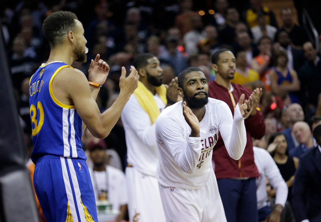 . Cleveland Cavaliers guard Kyrie Irving (2) reacts to a play on the bench against the Golden State Warriors in the first half of Game 4 of basketball\'s NBA Finals in Cleveland, Friday, June 9, 2017. (AP Photo/Tony Dejak)