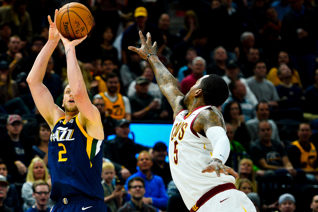 . Utah Jazz forward Joe Ingles (2) shoots over Cleveland Cavaliers guard JR Smith (5) in the second half of an NBA basketball game Saturday, Dec. 30, 2017, in Salt Lake City. (AP Photo/Alex Goodlett)