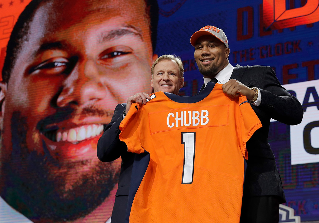 . Commissioner Roger Goodell, left, poses with North Carolina State\'s Bradley Chubb after Chubb was selected by the Denver Broncos during the first round of the NFL football draft, Thursday, April 26, 2018, in Arlington, Texas. (AP Photo/David J. Phillip)
