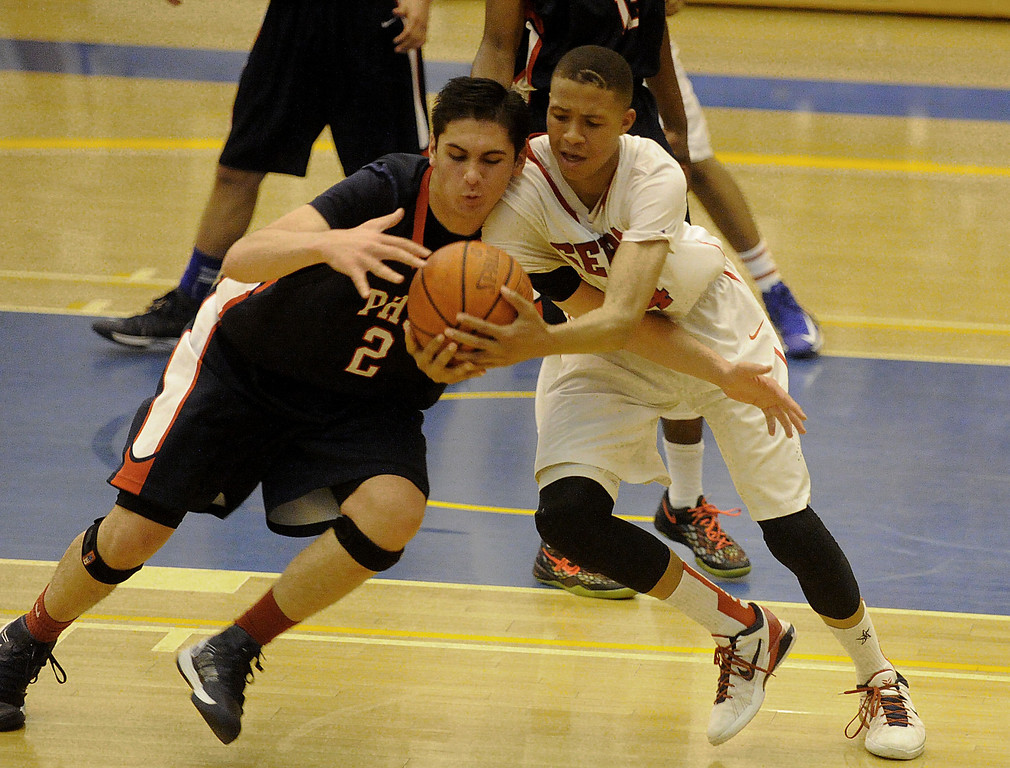 . 03-12-2013--(LANG Staff Photo by Sean Hiller)-Pacific Hills beat Serra 53-50 in Tuesday\'s boys basketball IV Southern California Regional semifinal at L.A. Southwest College. Pacific Hills\' Adam Plax, left, wrestles for the ball with Serra\'s Ron Freeman.