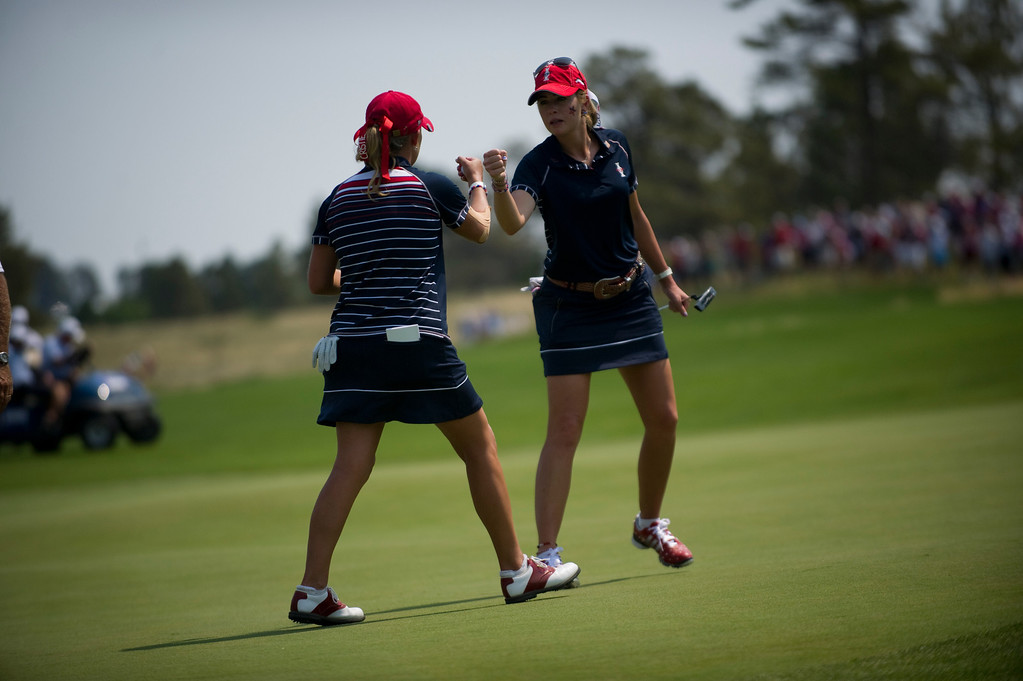 . PARKER, CO - AUGUST 16: Americans Paula Creamer, right and Cristie Kerr celebrate after surviving one more hole on the sixteenth hole during the first day of the Solheim Cup at Colorado Golf Club, on August 16, 2013.  (Photo By Grant Hindsley/The Denver Post)