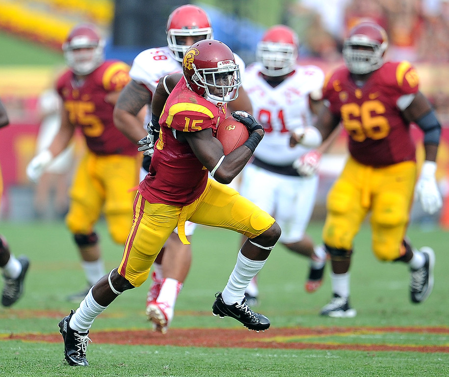 . Southern California wide receiver Nelson Agholor (15) catches a pass for a first down against Utah during the second half of an NCAA college football game in the Los Angeles Memorial Coliseum in Los Angeles, on Saturday, Oct. 26, 2013. Southern California won 19-3.   (Photo by Keith Birmingham/Pasadena Star-News)