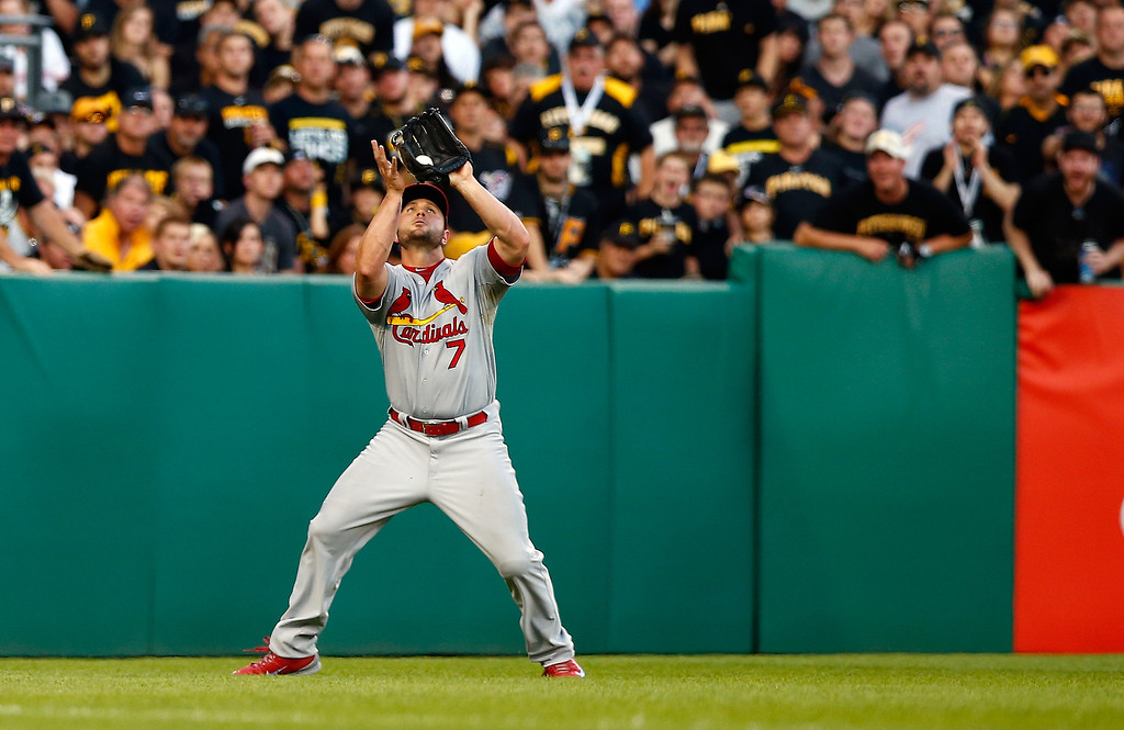. Matt Holliday #7 of the St. Louis Cardinals catches a fly ball hit by Justin Morneau #66 of the Pittsburgh Pirates in the sixth inning during Game Three of the National League Division Series at PNC Park on October 6, 2013 in Pittsburgh, Pennsylvania.  (Photo by Jared Wickerham/Getty Images)