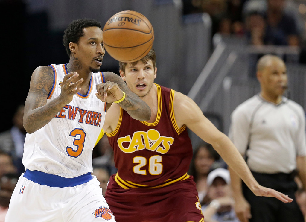 . New York Knicks\' Brandon Jennings (3) passes against Cleveland Cavaliers\' Kyle Korver (26) in the first half of an NBA basketball game, Thursday, Feb. 23, 2017, in Cleveland. (AP Photo/Tony Dejak)