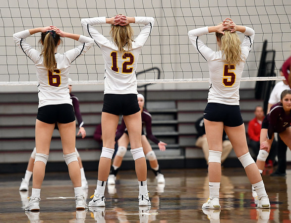 11/14/2019 Mike Orazzi | StaffrSt. Joseph High School's Morgan Jose (3), Ava Tuccio (12) and Katie Spangenberg (5) during the Class L Second Round Girls Volleyball Tournament against Bristol Central at BCHS. r