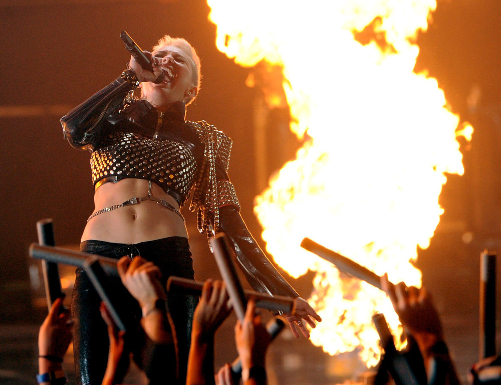 ". LOS ANGELES, CA - DECEMBER 16:  Singer Miley Cyrus performs onstage during ""VH1 Divas\"" 2012 at The Shrine Auditorium on December 16, 2012 in Los Angeles, California.  (Photo by Kevin Winter/Getty Images)"