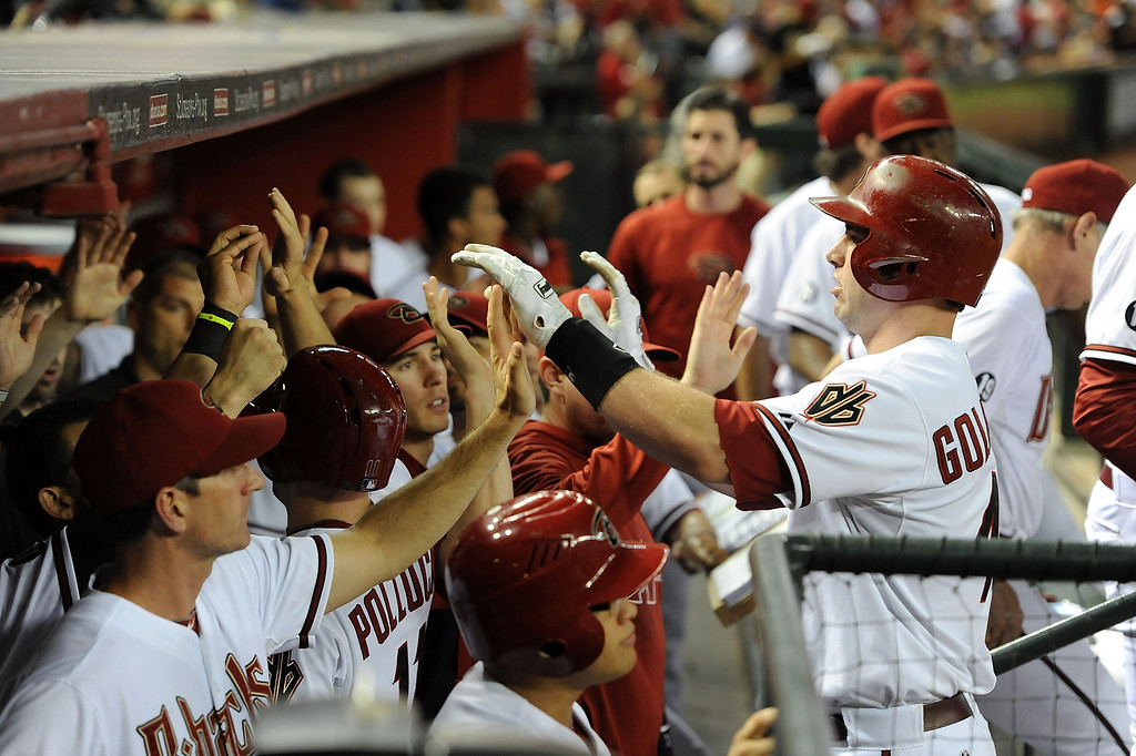 . PHOENIX, AZ - SEPTEMBER 16:  Paul Goldschmidt #44 of the Arizona Diamondbacks celebrates with teammates after hitting a two-run home run in the first inning against the Los Angeles Dodgers at Chase Field on September 16, 2013 in Phoenix, Arizona.  (Photo by Norm Hall/Getty Images)