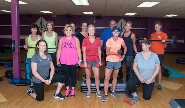 08/27/18 Wesley Bunnell | Staff Healthtrax Fitness & Wellness' Kim Connors, kneeling left, poses with her Bootcamp Class at their Bristol location on Monday evening.