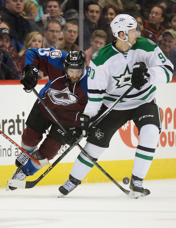 . Colorado Avalanche center Maxime Talbot (25) tries to steal the puck from Dallas Stars center Jason Spezza (90) during the first period Saturday, February 14, 2015 at the Pepsi Center in Denver, Colorado. (Photo By Brent Lewis/The Denver Post)