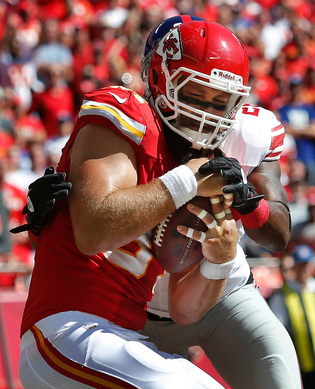 . Kansas City Chiefs tight end Sean McGrath, front, makes a touchdown catch while covered by New York Giants strong safety Antrel Rolle during the first half of an NFL football game at Arrowhead Stadium in Kansas City, Mo., Sunday, Sept. 29, 2013. (AP Photo/Ed Zurga)