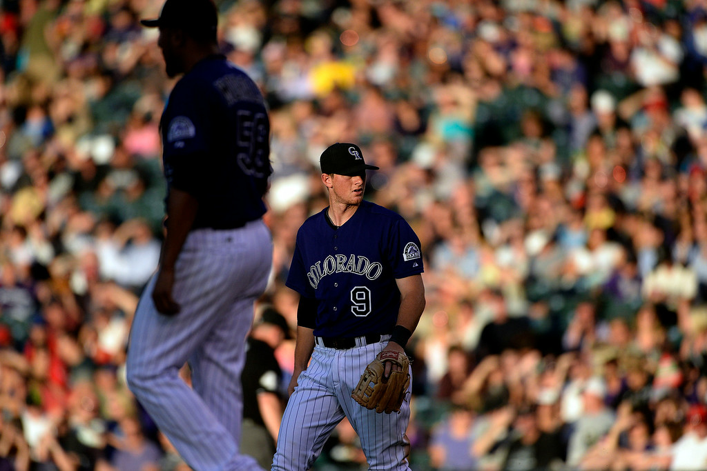 . D.J. LeMahieu (9) of the Colorado Rockies reacts to not being able to keep his foot on first base allowing Doug Fister (58) of the Washington Nationals to reach safely at Coors Field. Major League Baseball action between the Colorado Rockies and the Washington Nationals on Monday, July 21, 2014. (Photo by AAron Ontiveroz/The Denver Post)