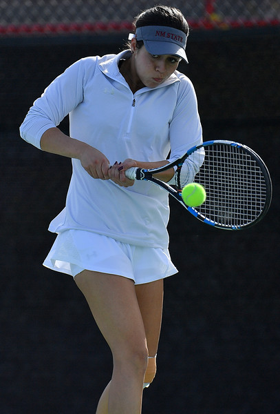 LAS VEGAS, NV - JANUARY 20:  Yadira Rubio of the New Mexico State Aggies plays a backhand during her match against Dominique Beauvais of the Weber State Wildcats at the Frank and Vicki Fertitta Tennis Complex in Las Vegas, Nevada. Rubio won the match 6-2, 6-3.