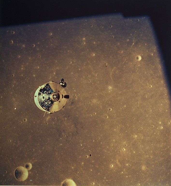 . A view of the Apollo Command Module with astronaut Michael Collins aboard as seen from the Lunar Module, July 20, 1969. Astronauts Neil Armstrong and Edwin Aldrin in the Lunar Module have separated from Apollo 11 and prepare to go to the lunar surface.  Moon terrain in background is the far side of the moon. (AP Photo/NASA)