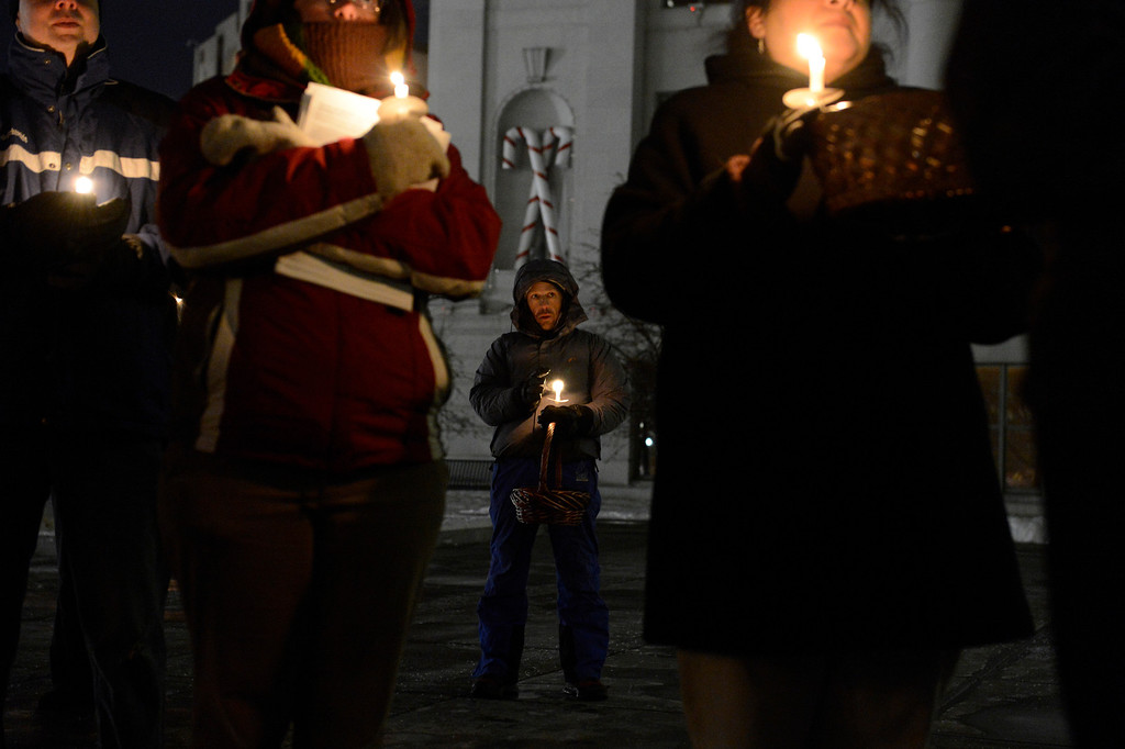 . John Radloff holds his candle as people gathered on the steps of the City & County Building to pay their respect to the homeless men, women and children who have passed away  during a candle vigil  Wednesday, December 19, 2012. Mayor Hancock read some of the 147 names of those who have perished. John Leyba, The Denver Post