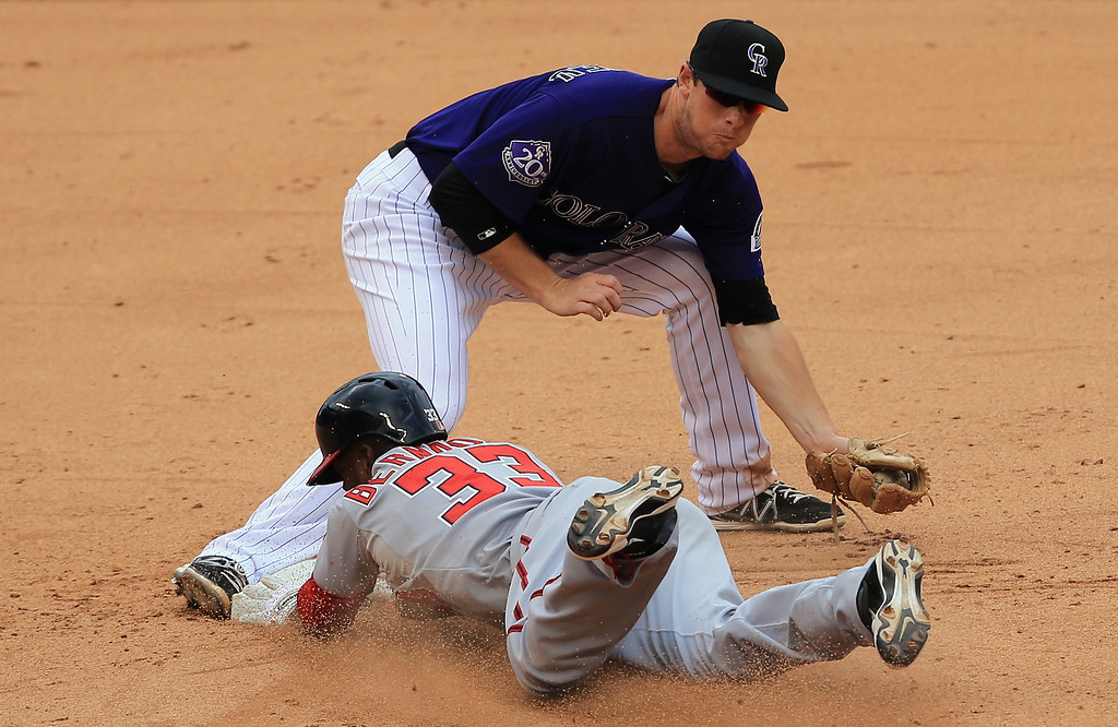 . Roger Bernadina #33 of the Washington Nationals slides into second with a pinch hit double as second baseman DJ LeMahieu #9 of the Colorado Rockies takes the throw at Coors Field on June 13, 2013 in Denver, Colorado.  (Photo by Doug Pensinger/Getty Images)