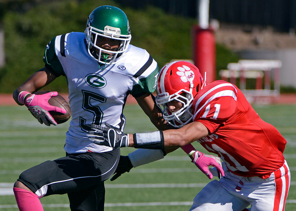 . <p>16. CALEB COLEMAN � WIDE RECEIVER � ST. MARY\'S</p> Coleman (11) tackles El Cerrito\'s Marquis Pippins (5) in the second quarter of their game in Albany, Calif., on Saturday, October 27, 2012. (Jose Carlos Fajardo/Staff)