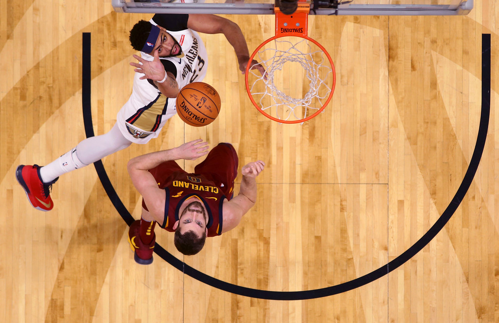. New Orleans Pelicans forward Anthony Davis (23) shoots against Cleveland Cavaliers forward Kevin Love (0) in the first half of an NBA basketball game in New Orleans, Saturday, Oct. 28, 2017. (AP Photo/Gerald Herbert)