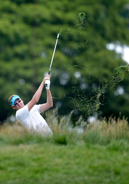 . Ian Poulter of England plays a shot on the first hole during the final round of the US Open at Merion Golf Club on June 16, 2013 in Ardmore, Pennsylvania.    BRENDAN SMIALOWSKI/AFP/Getty Images