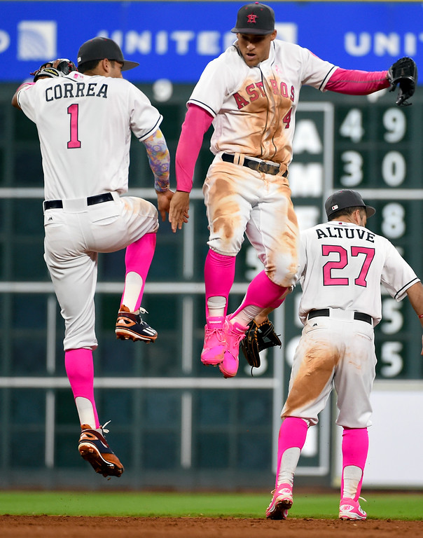 . Houston Astros\' Carlos Correa (1) and George Springer celebrate the Astros\' 5-1 victory over the Seattle Mariners in a baseball game, Sunday, May 8, 2016, in Houston. (AP Photo/Eric Christian Smith)