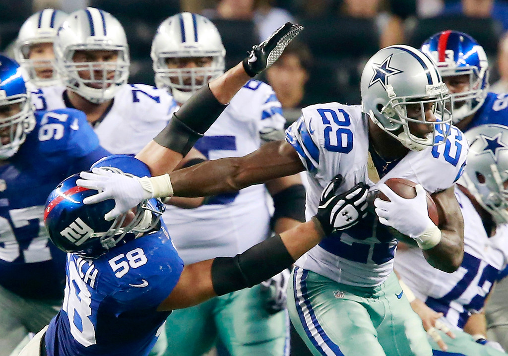 . Dallas Cowboys running back DeMarco Murray (29) tries to keep away New York Giants middle linebacker Mark Herzlich (58) during the second half of an NFL football game, Sunday, Sept. 8, 2013, in Arlington, Texas. (AP Photo/Waco Tribune Herald, Jose Yau)