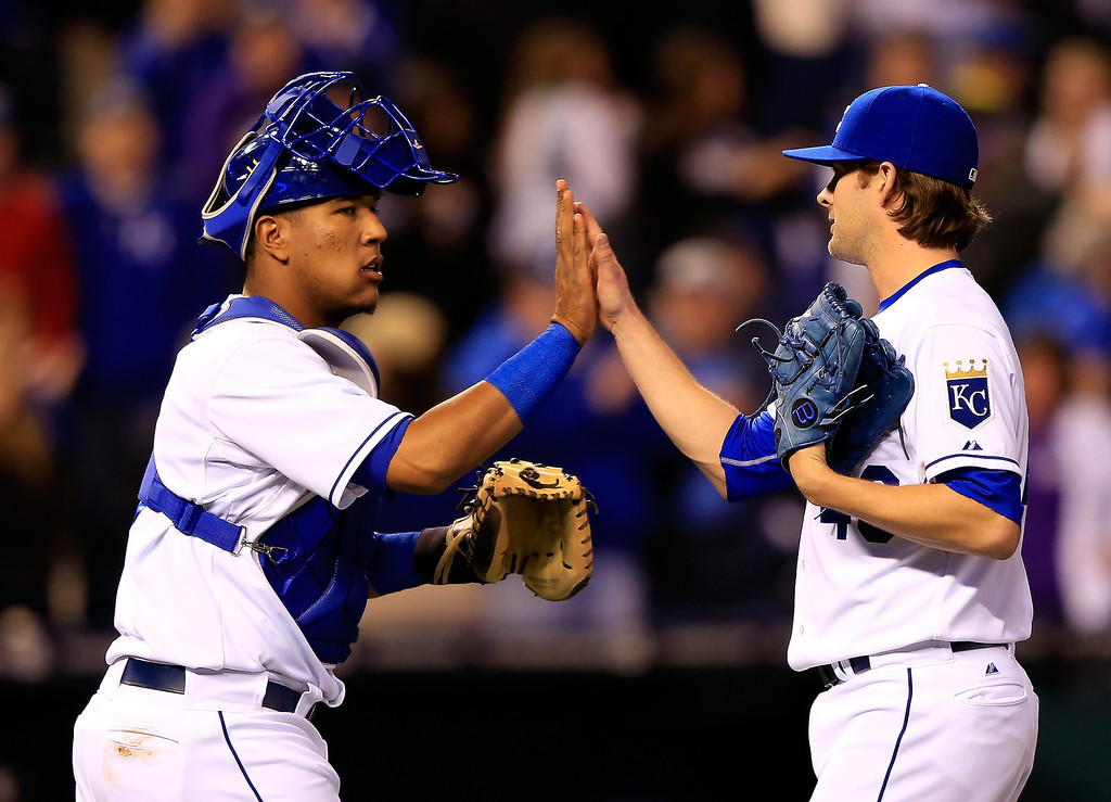 . Aaron Crow #43 of the Kansas City Royals is congratulated by Salvador Perez #13 after the Royals defeated the Colorado Rockies 5-1 to win the game against the Colorado Rockies at Kauffman Stadium on May 13, 2014 in Kansas City, Missouri.  (Photo by Jamie Squire/Getty Images)