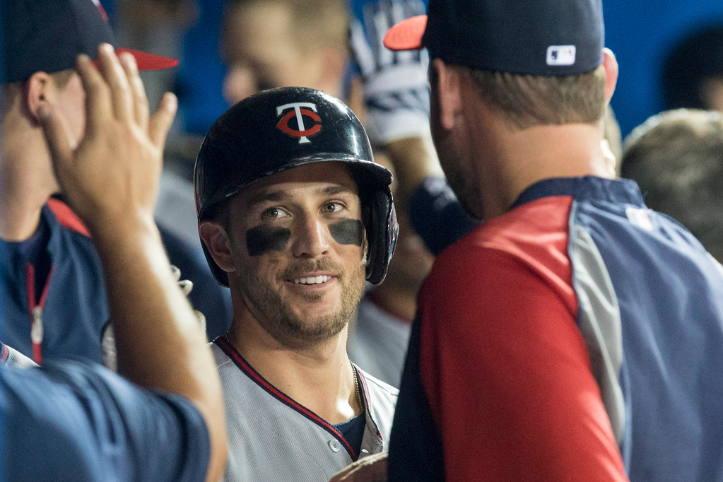 . Minnesota\'s Trevor Plouffe celebrates in the dugout after hitting a two-run homer against the Blue Jays during eighth inning. (AP Photo/The Canadian Press, Chris Young)