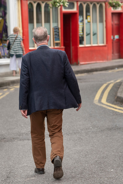 Senior man walking down the street, Kinsale, County Cork, Ireland