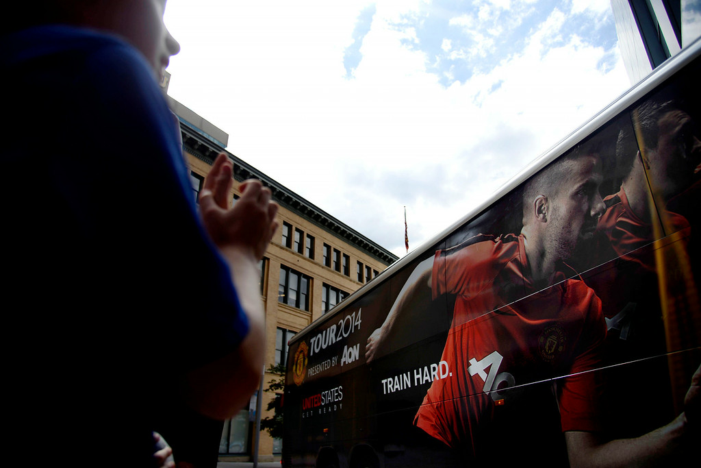 . DENVER, CO - JULY 24: The Manchester United soccer club arrives at their hotel by way of a bus as fans clap. Manchester United will play Italian squad Roma on Saturday, July 26 and arrived in Denver on Thursday, July 24, 2014. (Photo by AAron Ontiveroz/The Denver Post)
