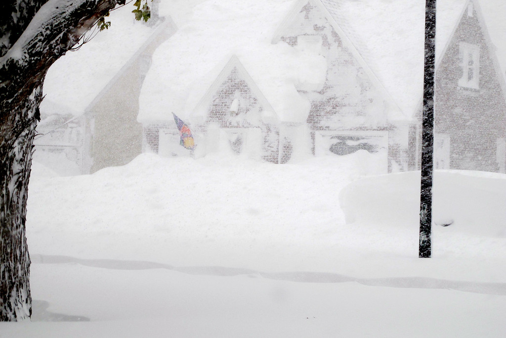 . A house is obscured by wind-blown, lake-effect snow on Tuesday, Nov. 18, 2014 in Buffalo, N.Y. Parts of New York measured the season\'s first big snowfall in feet, rather than inches,  as 3 feet of lake-effect snow blanketed the Buffalo area.  The Thruway Authority said white-out conditions caused by wind gusts of more than 30 mph forced the closure of Interstate 90 in both directions from the Rochester area to Ripley, on the Pennsylvania border 60 miles southwest of Buffalo.  (AP Photo/Carolyn Thompson)