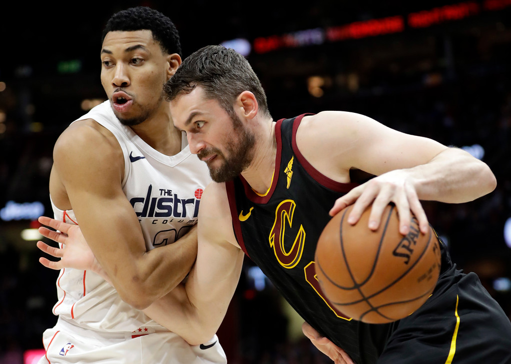 . Cleveland Cavaliers\' Kevin Love, right, drives past Washington Wizards\' Otto Porter Jr. in the first half of an NBA basketball game, Thursday, April 5, 2018, in Cleveland. (AP Photo/Tony Dejak)