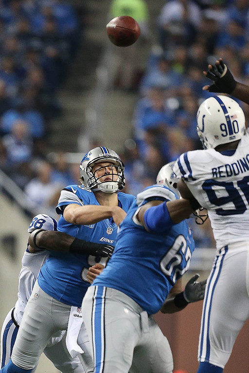 . Sergio Brown #38 of the Indianapolis Colts hits Matthew Stafford #9 of the Detroit Lions during the game at Ford Field on December 2, 2012 in Detroit, Michigan. (Photo by Leon Halip/Getty Images)