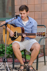 KITCHENER, Ont. (23/07/2016) - Singer-songwriter, Andrew Maranta participates in front of a small crowd during his first Schneider Creek Porch Party at Bread & Roses Saturday evening in Kitchener, Ont.  Maranta has been playing for eight years.  Photos by Alicia Wynter/The Record