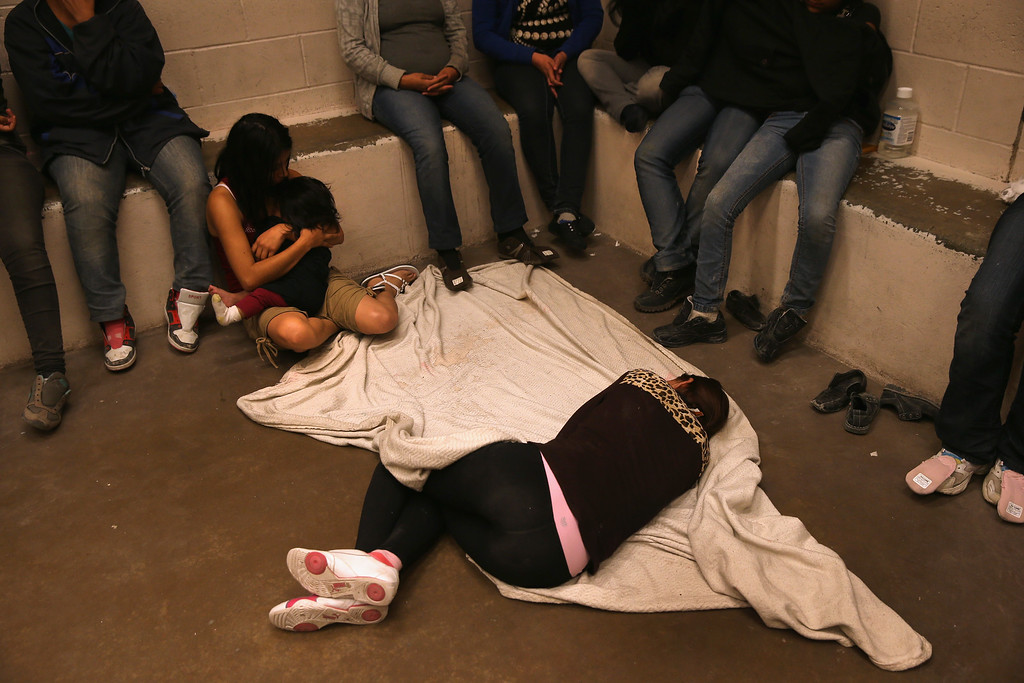 . Women and children wait in a holding cell at a U.S. Border Patrol processing center after being detained by agents near the U.S.-Mexico border on September 8, 2014 near McAllen, Texas. (Photo by John Moore/Getty Images)